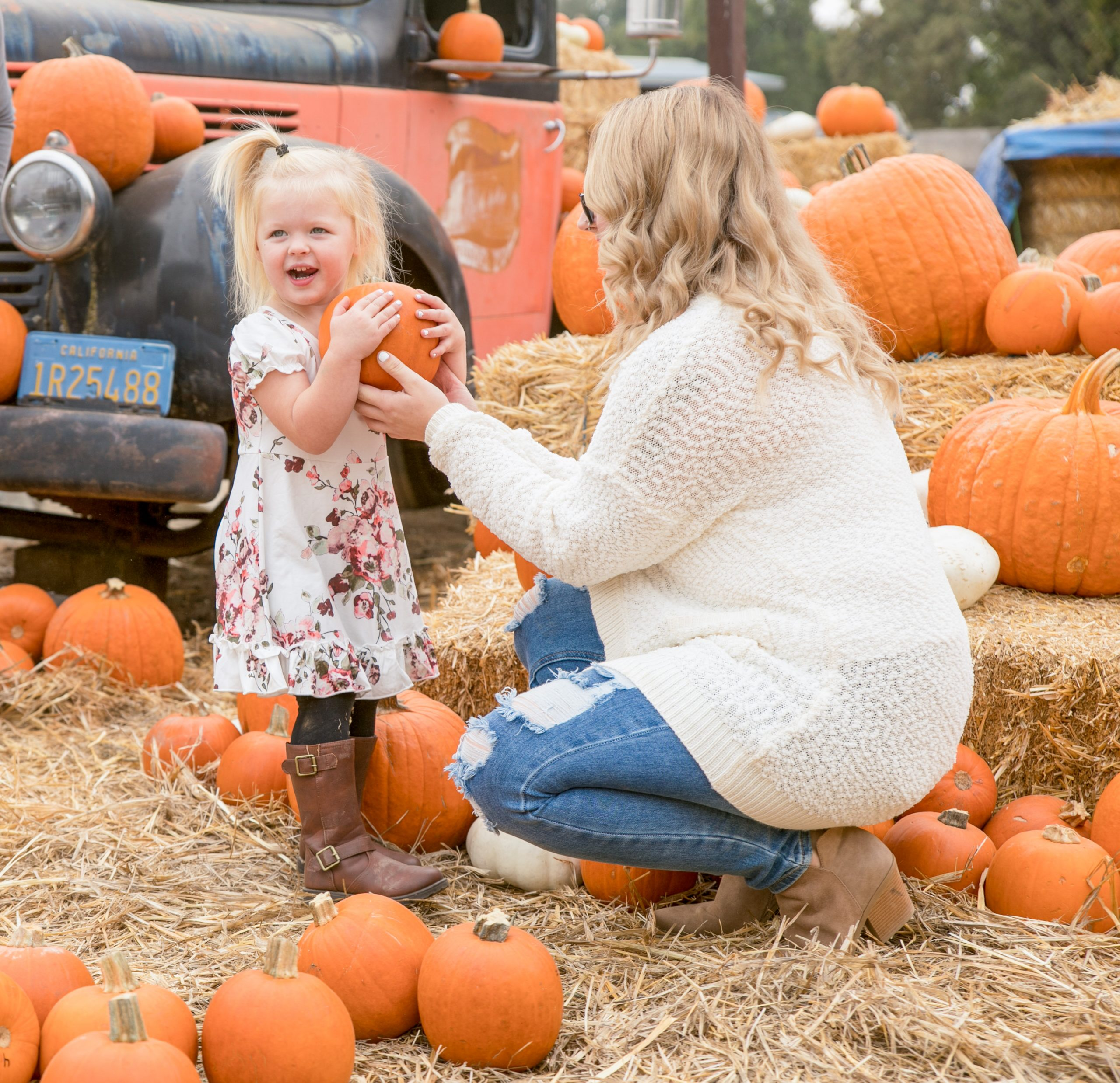 Mother and child in pumpkin patch